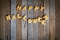 Halloween letters of bread on the wooden floor . Royalty Free Stock Photo