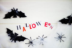 Halloween Letters cut out from the Magazines, Bats, Web and Blac Royalty Free Stock Photos