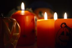 Halloween Lighted Orange Candles stock image