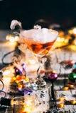 Halloween: Lights Glow Around Orange Potion In Martini Glass Stock Photography