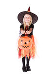 Halloween: Little Girl Witch Holds Out Pumpkin Bucket For Treats Stock Photos