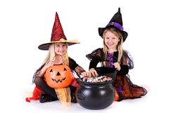 Halloween: Little Girls Ready To Grab Halloween Candy stock photos