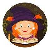 Halloween. Little whitch-girl reading a spellbook Royalty Free Stock Image