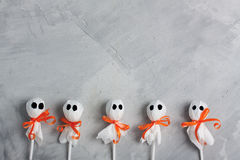 Halloween lollipop ghosts on gray concrete background. Horizontal orientation Stock Photography