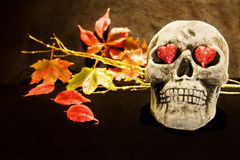 Halloween love with scary skull. Celebrating Halloween night with scary skull and red hearts Stock Images