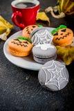 Halloween macaron cookies stock image