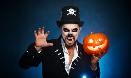 Halloween. magic skeleton with pumpkin. man in makeup and cost. Halloween. magic skeleton with a pumpkin. man in makeup and costume royalty free stock photo