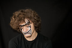 Halloween. Make-up on a face of the young man Stock Photography
