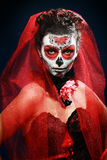 Halloween make up sugar skull. Beautiful model with perfect hairstyle. Santa Muerte concept royalty free stock photos