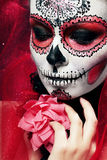 Halloween make up sugar skull. Beautiful model with perfect hairstyle. Santa Muerte concept royalty free stock image