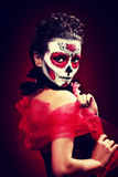 Halloween make up sugar skull. Beautiful model with perfect hairstyle. Santa Muerte concept. Fashion retro toning royalty free stock photos