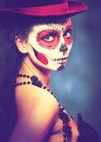 Halloween make up sugar skull. Sugar skull girl in hat halloween concept Fashion retro toning Stock Image