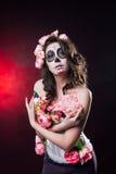 Halloween-make-upvrouw van Santa Muerte stock foto's