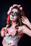 Halloween-make-upvrouw van Santa Muerte stock fotografie