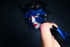 Halloween Makeup. Fantasy Bird Woman with Artistic Make-up. On Blue Background and Copy space for Text Royalty Free Stock Photos
