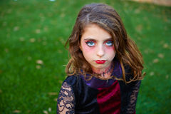 Halloween makeup kid girl blue eyes in outdoor lawn stock photo
