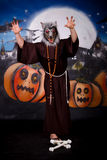 Halloween man character. Halloween character, man in creepy pose.    Studio shot, painted themed background Royalty Free Stock Photography