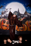 Halloween man character. Halloween character, man in creepy pose.    Studio shot, painted themed background Stock Images