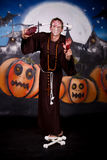 Halloween man character. Halloween character, man impersonating Freddy Kruger.    Studio shot, painted themed background Royalty Free Stock Photography