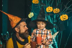 Halloween man and child in witch hat. Royalty Free Stock Image