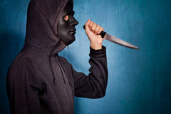 Halloween man with mask and knife Royalty Free Stock Image