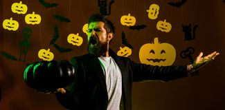 Halloween man with pumpkin in darkness. Happy hipster with bloody beard with pumpkins. Trick or treat. Jack-o-lanterns. Halloween man with pumpkin in darkness royalty free stock photos