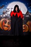 Halloween man vampire. Halloween man horror character vampire, Dracula. Studio, painted themed background Royalty Free Stock Photography