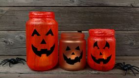 Halloween mason jar Jack o Lanterns stock video footage
