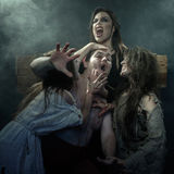 Halloween. The Middle Ages. Three evil witches kill his executio. Ner stock photography