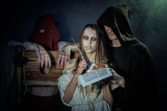 Halloween. The Middle Ages. Witch sign a verdict of the Inquisit Royalty Free Stock Photos