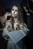 Halloween. The Middle Ages. Witch sign a verdict of the Inquisit. Ion stock photos