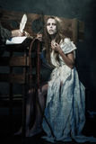 Halloween. The Middle Ages. Witch sign a verdict of the Inquisit. Ion Royalty Free Stock Photos