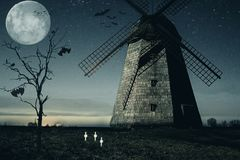 Halloween mill with Moon and bats Stock Photo