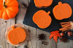 Halloween mini pumpkin shaped pies, overhead scene Stock Images