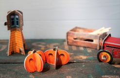 Halloween with mini pumpkins and vintage farm decor stock images