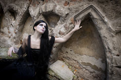 Halloween Misterious Dressed Gothic Woman. Misterious woman dressed in black gothic dress Stock Image