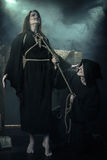 Halloween. Monk executed witch. The Middle Ages.  stock photo