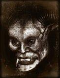 Halloween Monster. Creepy halloween monster on dark background Stock Photo