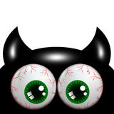 Halloween monster with green eyes with place for text Stock Photo