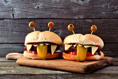 Halloween monster hamburgers against old wood Royalty Free Stock Image