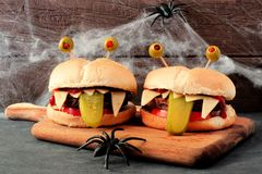Halloween monster hamburgers with spider web background Stock Image