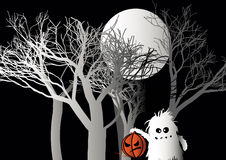 Halloween monster with pumpkin in forest Stock Photo