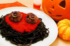 Halloween monster spaghetti. With meat eyeballs and decor Royalty Free Stock Image