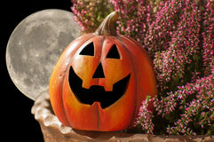 Halloween moon. Typical festive Halloween activities include attending costume parties and carving pumpkins Royalty Free Stock Images