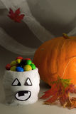 Halloween. Mummy-bowl with candies and pumpkin Royalty Free Stock Photo