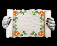 Halloween mummy holding scroll. Space for text. Stock Image