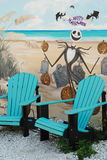 Halloween Mural at Beach. Two blue adirondak chairs sitting in front of Halloween mural on side of building outside in Dunedin, Florida Stock Image