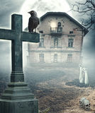 Halloween mystical spooky background with cross and haunted hous Stock Photos