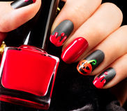 Halloween nail art design. Black matte nailpolish Royalty Free Stock Photos