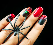 Halloween Nail art design. Black matte polish Stock Photos